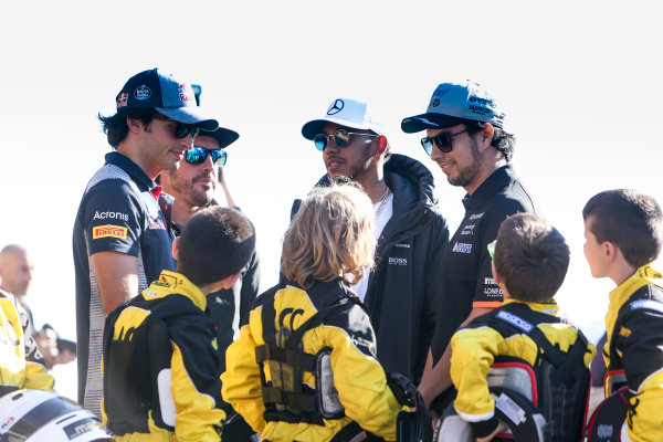 Circuit de Catalunya, Barcelona, Spain. Thursday 11 May 2017. Carlos Sainz Jr, Toro Rosso, Fernando Alonso, McLaren, Lewis Hamilton, Mercedes AMG, and Sergio Perez, Force India, with some junior Kart racers. World Copyright: Dom Romney/LAT Images ref: Digital Image GT2R9791