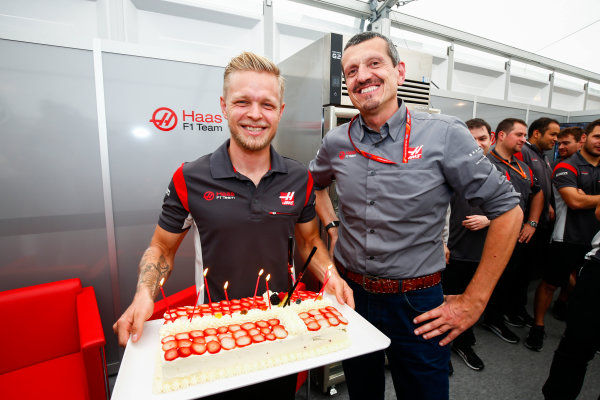 Suzuka Circuit, Japan. Thursday 05 October 2017. Kevin Magnussen, Haas F1, is presented with a birthday cake by Guenther Steiner, Team Principal, Haas F1. World Copyright: Andy Hone/LAT Images  ref: Digital Image _ONY6093