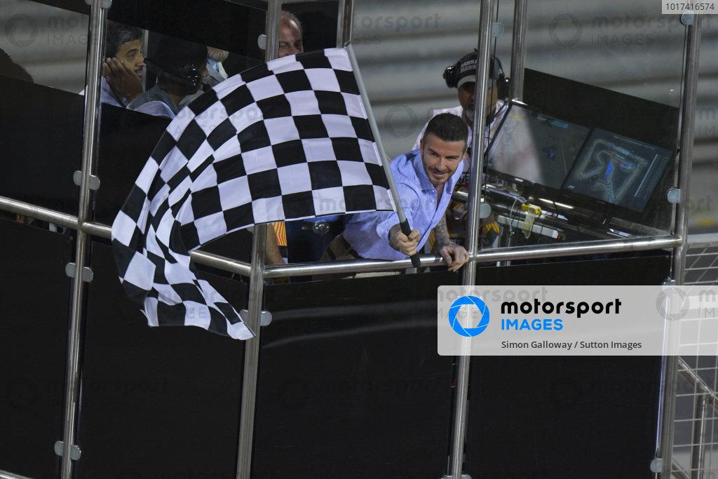 David Beckham waves the chequered flag
