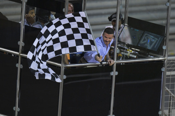 David Beckham waves the chequered flag