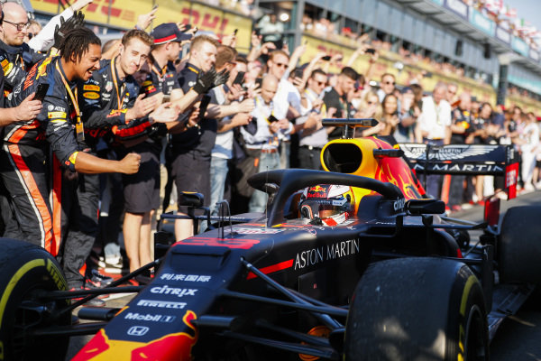 Max Verstappen, Red Bull Racing RB15 driving past his team celebrates on the way to Parc Ferme