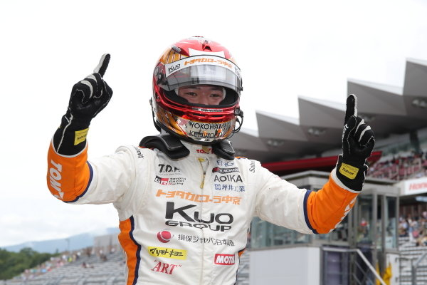 Winner Ritomo Miyata ( #37 Corolla Chukyo Kuo TOM'S Dallara F317 Toyota), raises his fingers in celebration at the finish.