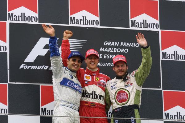 2001 Spanish Grand PrixCatalunya, Barcelona, Spain. 27-29 April 2001.Juan-Pablo Montoya (Williams BMW) 2nd position, Michael Schumacher (Ferrari) 1st position and Jacques Villeneuve (B.A R. Honda) 3rd position, celebrate on the podium.World Copyright - LAT Photographicref: 8 9 MB Digital File