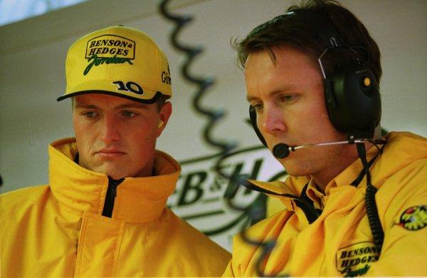 1998 Belgian Grand Prix.Spa-Francorchamps, Belgium. 28-30 August 1998.Ralf Schumacher (Jordan Mugen Honda) and his race engineer Sam Michael, watch practice from the garage.World Copyright - Steve Etherington/LAT Photographic