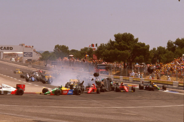 Paul Ricard, Le Castellet, France.7-9 July 1989.Mauricio Gugelmin (March CG891 Judd) has a huge crash on the start of the race at Epingle Ecole.Ref-89 FRA 07.World Copyright - LAT Photographic