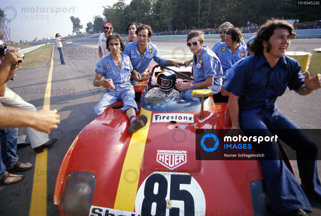 Jacky Ickx in his winning SEFAC Ferrari, Ferrari 312PB ferries his mechanics towards the podium.