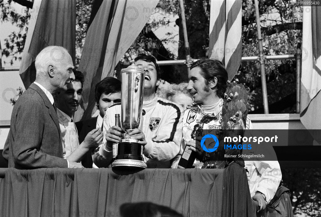 Jo Siffert and Brian Redman, 1st position, celebrate victory on the podium.