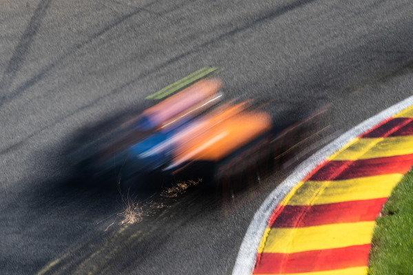 Lando Norris, McLaren MCL34, kicks up sparks
