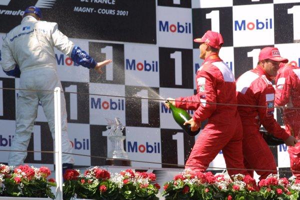 2001 French Grand Prix - RaceMagny-Cours, France. 1st July 2001Race podium, Michael Schumacher, Ferrari F2001 (1st), Ralf Schumacher, BMW Williams FW23 (2nd) and Rubens Barrichello, Ferrari F2001 (3rd).World Copyright - LAT Photographicref: 8 9 MB Digital File only