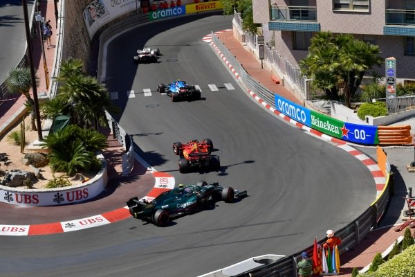 Nikita Mazepin, Haas VF-21, leads Esteban Ocon, Alpine A521, Charles Leclerc, Ferrari SF21, and Sebastian Vettel, Aston Martin AMR21