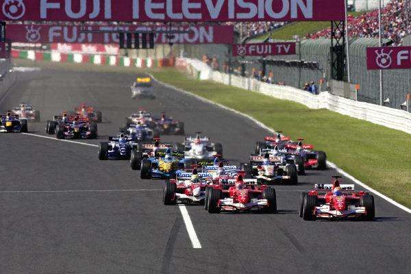Felipe Massa, Ferrari 248 F1 leads Michael Schumacher, Ferrari 248 F1 and Ralf Schumacher, Toyota TF106B at the start.