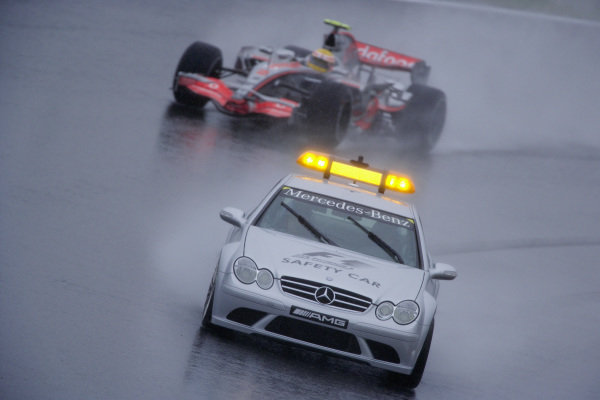 The Safety Car makes a reappearance during the race with Lewis Hamilton, McLaren MP4-22 Mercedes behind.