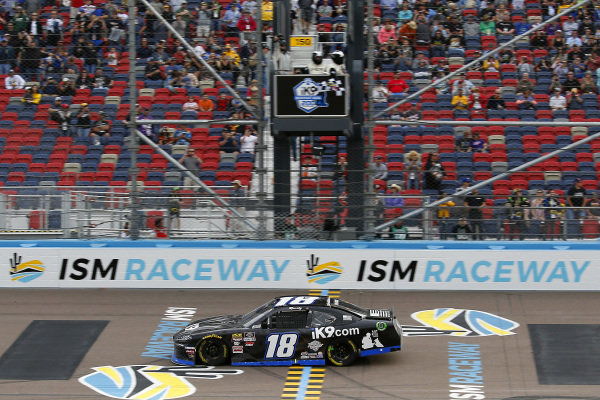 #18: Kyle Busch, Joe Gibbs Racing, Toyota Supra Extreme Concepts/iK9 drives under the checkered flag to win