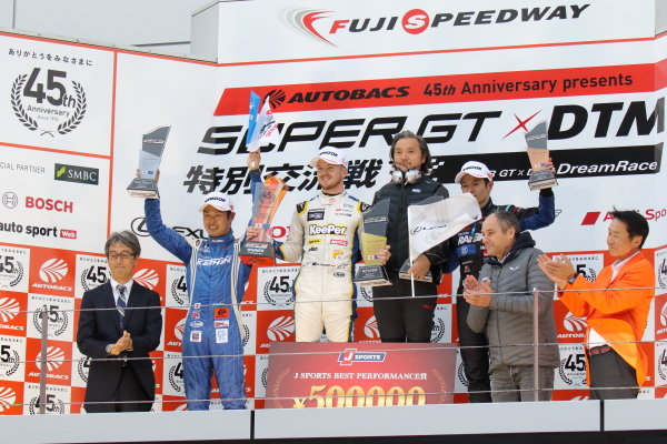 Super GT - DTM Dream Race. The race one podium. Winner Nick Cassidy Lexus Team KeePer TOM's, Lexus LC 500 GT500, stands above Koudai Tsukakoshi, Keihin Real Racing, Honda NSX-GT, 2nd position and Naoki Yamamoto, Raybrig Team Kunimitsu, Honda NSX-GT, 3rd