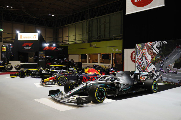 A Renault R.S.19, a Red Bull Racing RB15 and a Mercedes AMG F1 W10 on the F1 Racing stand
