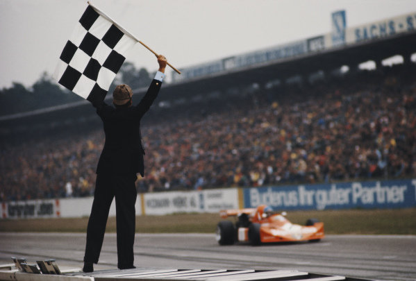The chequered flag falls as Hans-Joachim Stuck, March Engineering, March 752 BMW M12 wins Heat 2.