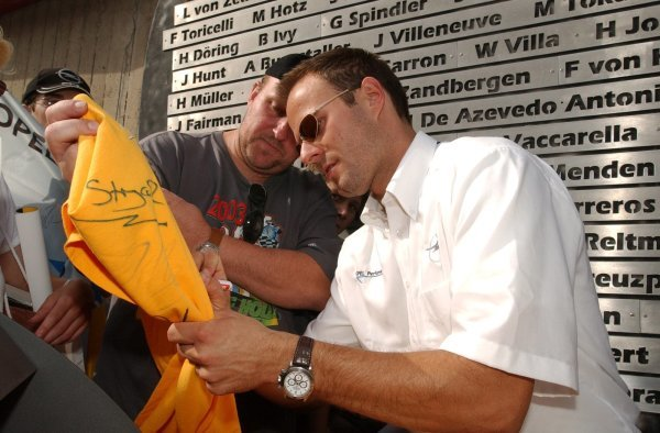 Marcel Tiemann (GER), signing autographs for the fans. Revealing of the winners names of the Nürburgring 24Hrs race. DTM Championship, Rd 7, Nürburgring, Germany. 16 August 2003. DIGITAL IMAGE