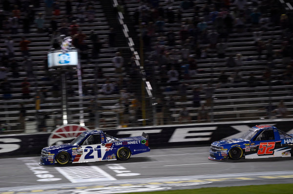 #21: Johnny Sauter, GMS Racing, Chevrolet Silverado ISM Connect, crosses the finish line to win in Texas.