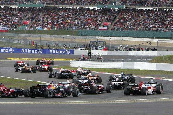 2007 European Grand Prix - Sunday RaceNurburgring, Germany.22nd July 2007.Kimi Raikkonen, Ferrari F2007, retired, leads Felipe Massa, Ferrari F2007, 2nd position, Fernando Alonso, McLaren MP4-22 Mercedes, 1st position, Lewis Hamilton, McLaren MP4-22 Mercedes, 9th position, Heikki Kovalainen, Renault R27, 8th position, Jarno Trulli, Toyota TF107, 13th position, Mark Webber, Red Bull Racing RB3 Renault, 3rd position, Alex Wurz, Williams FW29 Toyota, 4th position, Giancarlo Fisichella, Renault R27, 10th position, Nico Rosberg, Williams FW29 Toyota, retired, Takuma Sato, Super Aguri SA07-Honda, retired, Rubens Barrichello, Honda RA107, 11th position, and the rest of the field at the start. Action. Starts.World Copyright: Glenn Dunbar/LAT Photographicref: Digital Image IMG_5020