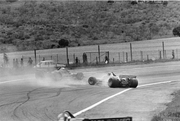 1979 Spanish Grand Prix. Jarama, Madrid, Spain. 27-29 April 1979. Gilles Villeneuve (Ferrari 312T4) 7th position, spins and is passed by team mate Jody Scheckter (Ferrari 312T4)4th position, action. World Copyright - LAT Photographic. ref: 12413/17.