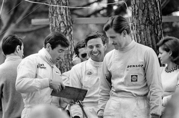 1966 Monaco Grand Prix. Monte Carlo, Monaco. 19-22 May 1966. Jackie Stewart, Jim Clark and Graham Hill in the pits. Portrait. World Copyright: LAT Photographic Ref: black & white/MotorSport calendar