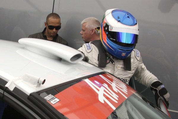 Lewis Hamilton (GBR), McLaren, left, with his brother Nicolas Hamilton (GBR), Total Control Racing, right, who is making his Renault Clio Cup racing debut this weekend. Renault Clio Cup, Rd1, Brands Hatch, England, 2 April 2011.