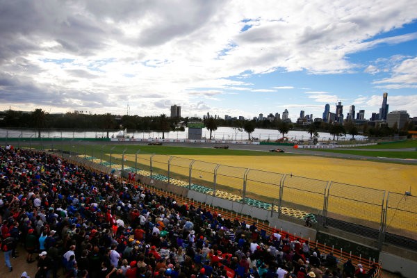 Albert Park, Melbourne, Australia. Sunday 16 March 2014. Romain Grosjean, Lotus E22 Renault, leads Sergio Perez, Force India VJM07 Mercedes. World Copyright: Charles Coates/LAT Photographic. ref: Digital Image _N7T2380