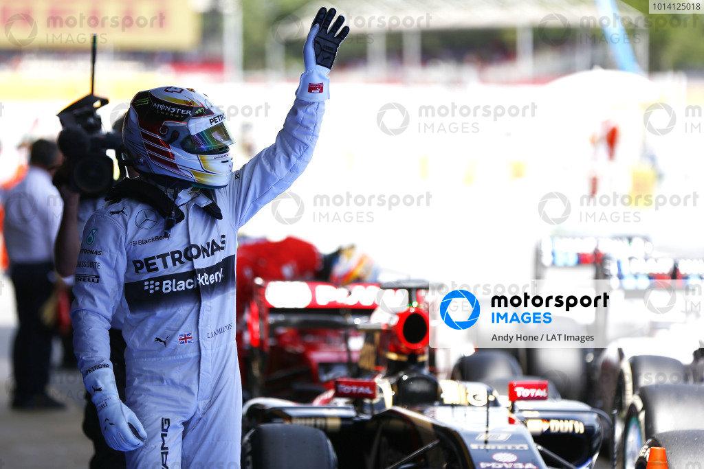 Circuit de Catalunya, Barcelona, Spain. Saturday 10 May 2014. Lewis Hamilton, Mercedes AMG, celebrates pole in Parc Ferme. World Copyright: Andy Hone/LAT Photographic. ref: Digital Image _ONZ0859