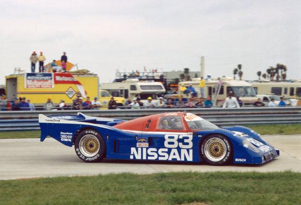 Sebring 12 Hours, Florida, USA. 16th March 1991. Rd 3. Geoff Brabham / Derek Daly / Gary Brabham (Nissan NPT-90), 1st position, action.  World Copyright: Bill Murenbeeld/LAT Photographic. Ref:  91IMSA SEB 05.