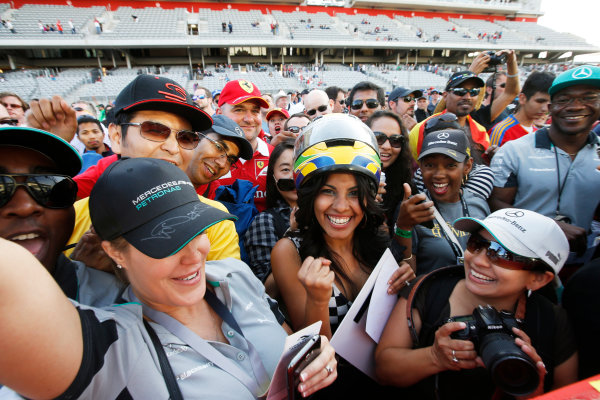 Circuit of the Americas, Austin, Texas, United States of America. Sunday 2 November 2014. Fans celebrate after the race. World Copyright: Charles Coates/LAT Photographic. ref: Digital Image _J5R1448