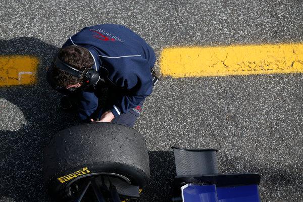 2014 GP3 Series Test 1. Estoril, Portugal.  Thursday 19 March 2015. Arden International mechanic checks brake temperature Photo: Sam Bloxham/GP3 Series Media Service. ref: Digital Image _SBL0660