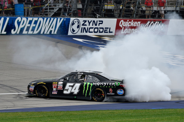 12-13 June, 2015, Brooklyn, Michigan USA Kyle Busch, Monster Energy Toyota Camry celebrates the win with a burn out ?2015 Scott R LePage  LAT Photo USA