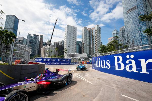 FIA Formula E Hong Kong e-Prix. Second Practice Session. Sebastien Buemi (SUI), Renault e.Dams, Spark-Renault, Renault Z.E 16, Jose Maria Lopez (ARG), DS Virgin Racing, Spark-Citroen, Virgin DSV-02. Hong Kong Harbour, Hong Kong, Asia. Sunday 9 October 2016. Photo: Adam Warner / FE / LAT ref: Digital Image _L5R7834