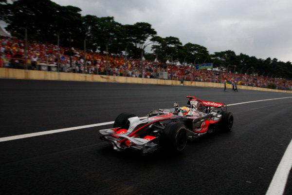 Interlagos, Sao Paulo, Brazil2nd November 2008Lewis Hamilton, McLaren MP4-23 Mercedes, 5th position, celebrates on his in lap. Action. Finish.World Copyright: Glenn Dunbar/LAT Photographic ref: Digital Image _O9T5618