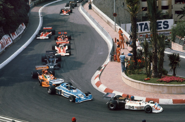 Monte Carlo, Monaco. 27th - 30th May 1976. Hans-Joachim Stuck (March 761-Ford), 4th position leads Jacques Laffite (Ligier JS5-Matra), 12th position, at the start of the race, action.  World Copyright: LAT Photographic.  Ref:  76 MON 11.