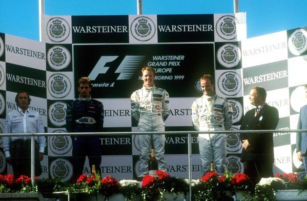 1st: Johnny Herbert (GBR) Stewart-Ford SF-3, 2nd: Rubens Barrichello (BRA) Stewart-Ford SF-3, 3rd: Jarno Trulli (ITA) Prost Peugeot AP02 Jackie Stewart joins his drivers in one of the proudest moments in his career. European Grand Prix, Rd 14, Nurburgring, Germany, 26 September 1999.