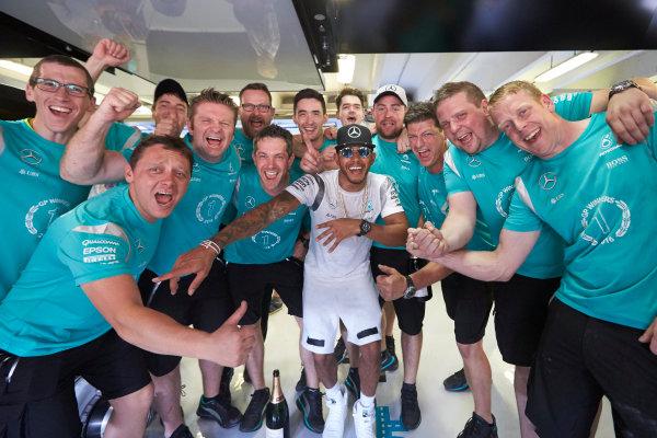 Hungaroring, Budapest, Hungary. Sunday 24 July 2016. Lewis Hamilton, Mercedes AMG celebrates with his mechanics after the race. World Copyright: Steve Etherington/LAT Photographic ref: Digital Image SNE27646