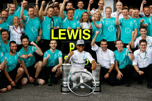 Hockenheim, Germany. Sunday 31 July 2016. Lewis Hamilton, Mercedes AMG, 1st Position, with the days trophy haul, celebrates with his team. World Copyright: Andrew Hone/LAT Photographic ref: Digital Image _ONY1507