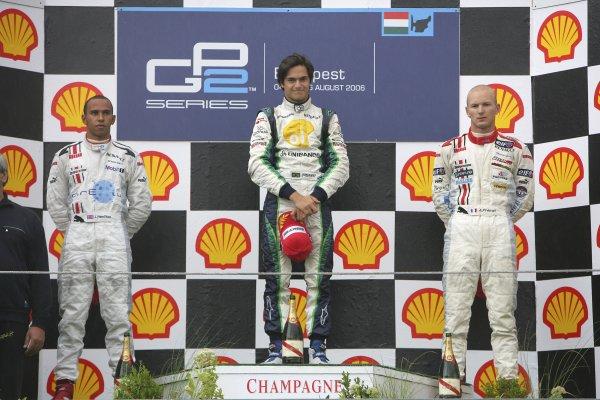 2006 GP2 Series Round 9. Hungaroring, Budapest, Hungary. 6th August 2006. Sunday race.Nelson Piquet Jr. (BRA, Piquet Sports) 1st, Lewis Hamilton (GBR, ART Grand Prix) 2nd, Alexandre Premat (FRA, ART Grand Prix) 3rd. Podium.World Copyright: Andrew Ferraro/GP2 Series Media Service. Ref: Digital Image Only.ZP9O0538 jpg