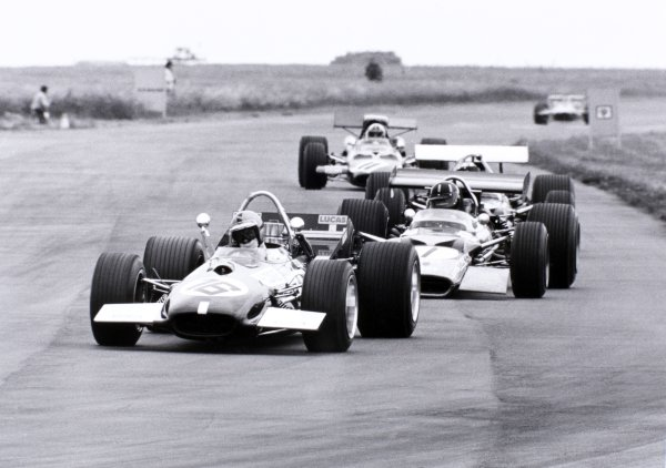 1969 British Grand Prix Silverstone, Great Britain. 19 July 1969 Piers Courage, Brabham BT26-Ford, 5th position, leads Graham Hill, Lotus 49B-Ford, 7th position, and Chris Amon, #11 Ferrari 312, retired, action World Copyright: LAT PhotographicRef: Autocar b&w