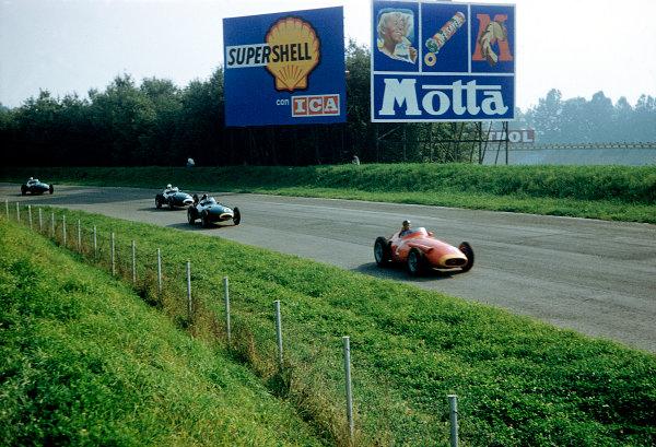 1957 Italian Grand Prix. Monza, Italy.6-8 September 1957.Juan Manuel Fangio (Maserati 250F) leads Tony Brooks and Stirling Moss (both Vanwall VW's).Ref-57 ITA 33.World Copyright - LAT Photographic