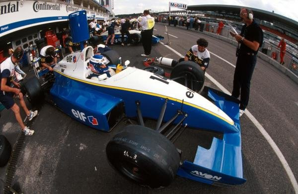 Race winner Olivier Panis (FRA) Reynard 93D Cosworth AC has his car worked on in the pits.