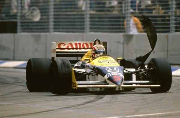 Nigel Mansell, Williams FW11 Honda, suffers a tyre blow-out.