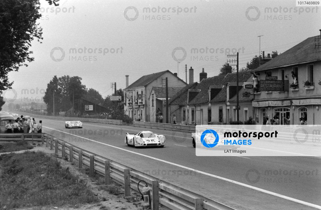 Jo Siffert / Brian Redman, J.W. Automotive Engineering, Porsche 917 K - Porsche 912, battles with Vic Elford / Kurt Ahrens Jnr., Porsche KG Salzburg, Porsche 917 LH - Porsche 912, with Pedro Rodriguez / Leo Kinnunen, J.W. Automotive Engineering, Porsche 917 K, just behind.