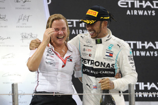 Lewis Hamilton, Mercedes AMG F1, 1st position, celebrates with the Mercedes trophy delegate on the podium