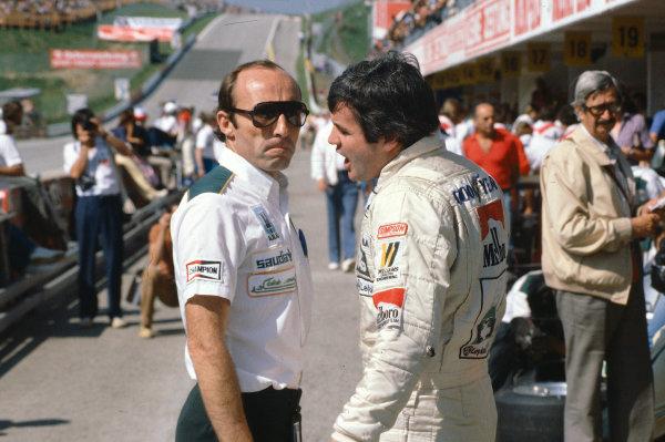 1980 Austrian Grand Prix.Osterreichring, Zeltweg, Austria.15-17 August 1980.Williams team boss Frank Williams talks with his driver Alan Jones.Ref-80 AUT 12.World Copyright - LAT Photographic