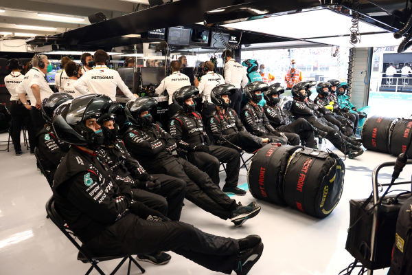 The Mercedes pit crew at rest in the garage