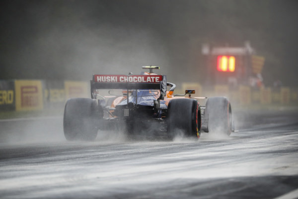 Lando Norris, McLaren MCL34, kicks up cement dust which was laid down to cover a heavy oil spill in the F2 race prior to the session