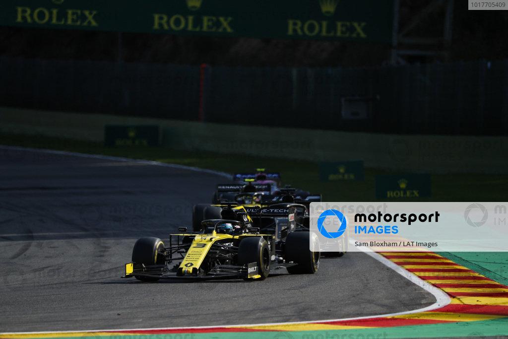 Daniel Ricciardo, Renault R.S.19, leads Romain Grosjean, Haas VF-19,