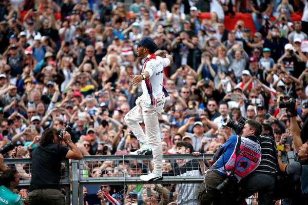 Silverstone, Northamptonshire, UK Sunday 10 July 2016. Lewis Hamilton, Mercedes AMG, 1st Position, celebrates victory at his home race with the fans. World Copyright: Dunbar/LAT Photographic ref: Digital Image _W2Q5465A